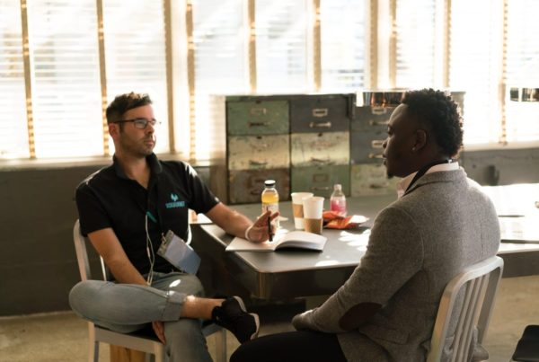 two-guys-talking-in-office